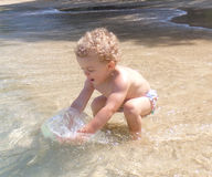 A toddler on a beach in the caribbean Royalty Free Stock Photos