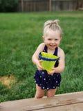 Toddler beach days. Beach, green, greenbucket, toddler, blue, blueswimsuit stock photography