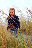 Toddler in beach grass Royalty Free Stock Image