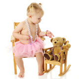 Toddler with Beads for Her Bear Stock Photo