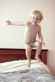 Toddler in bedroom Stock Image