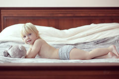 Toddler in bedroom Stock Images