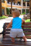 Toddler on bench. Toddler boy standing on outdoor bench royalty free stock images