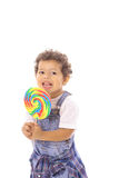 Toddler with big lollipop Royalty Free Stock Photography