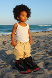 Toddler in Big Shoes Royalty Free Stock Photos