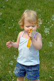 Toddler Blowing Bubbles Stock Images
