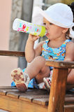 Toddler with bottle of milk Stock Image