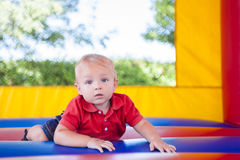 Toddler in Bounce House Stock Images
