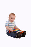 Toddler Boy. Small boy sitting playing with an abacus stock image