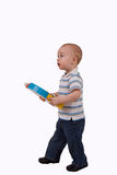 Toddler boy. Small boy walking with childs toy stock photography