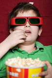 Toddler boy in 3D movie theater Stock Image