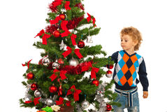 Toddler boy arrange Christmas tree Royalty Free Stock Photos