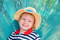 Toddler boy in beach chair royalty free stock images