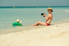 Toddler boy on beach with mother. Two year old toddler boy on beach with mother. Woman taking photo Stock Photography
