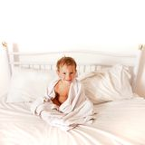 Toddler boy in bed after bath Stock Photography