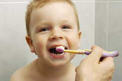 Toddler boy brushes teeth Royalty Free Stock Photos