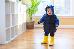 Toddler boy bundled up in winter clothes. Ready to go outside stock photos