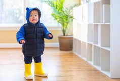 Toddler boy bundled up in winter clothes. Ready to go outside stock images