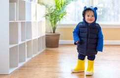 Toddler boy bundled up in winter clothes. Ready to go outside royalty free stock image