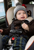 Toddler boy in the car seat Stock Photography