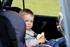 Toddler boy in the car seat Royalty Free Stock Images