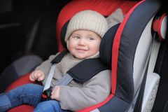 Toddler boy in car seat Stock Image