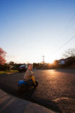 Toddler boy child riding tricycle on road Stock Photography