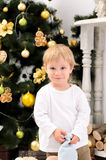 Toddler boy in christmas interior Stock Photos