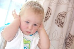 Toddler boy is closing his ears Royalty Free Stock Photography