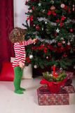 Toddler boy decorate Christmas tree Stock Photo