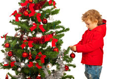 Toddler boy decorate Xmas tree Royalty Free Stock Photo