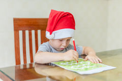 Toddler Boy draws felt pen path in the maze. Early development concept Stock Images