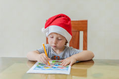 Toddler Boy draws felt pen path in the maze. Early development concept Stock Image