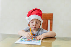 Toddler Boy draws felt pen path in the maze. Early development concept Royalty Free Stock Photo
