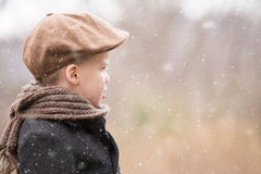 A toddler boy dressed warm looking ahead and Royalty Free Stock Images
