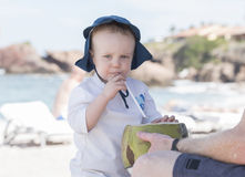 Toddler Boy Drinks from a Coconut on the Beach in Mexico Royalty Free Stock Image