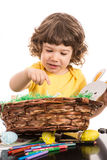 Toddler boy with Easter basket Stock Photos