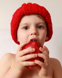 Toddler boy eating an apple royalty free stock images