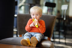 Toddler boy eating banana Royalty Free Stock Images