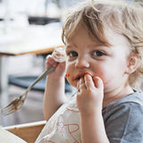 Toddler Boy Eating Pasta Stock Photography