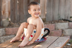 Toddler boy in giant teacup Royalty Free Stock Images