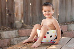 Toddler boy in giant teacup Stock Photos