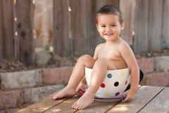 Toddler boy in giant teacup Stock Photos