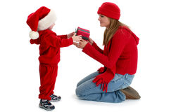Toddler Boy Giving Present To Young Woman. Shot in studio over white Stock Photography