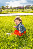 Toddler boy in green grass Royalty Free Stock Images