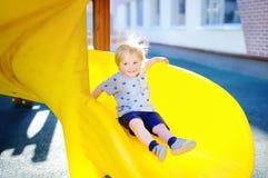 Toddler boy having fun on playground Stock Photos