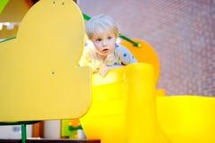Toddler boy having fun on playground Stock Images