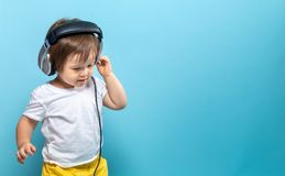 Toddler boy with headphones Stock Image