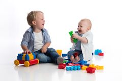 Toddler Boy and his Baby Brother Playing Together Stock Photos