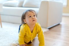 Toddler boy in his house royalty free stock photo